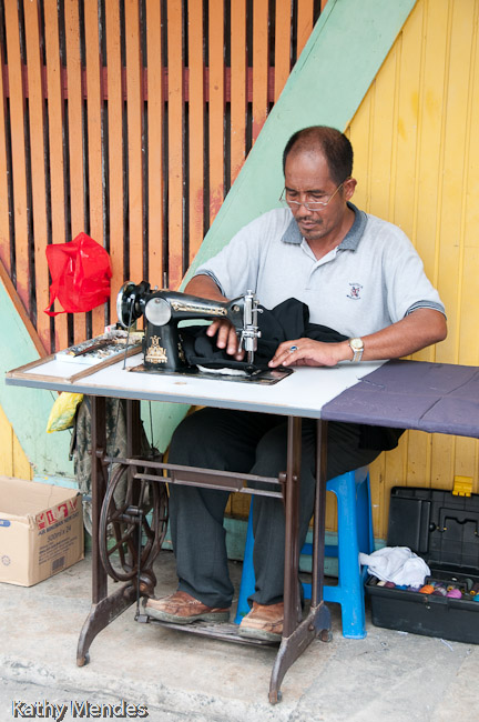 Tailors work outside the market along the street.