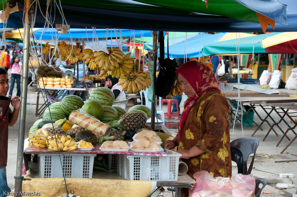 Woman selling fruit at the outside market.