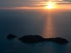 Sun sets over small islands near Kota Kinabalu.