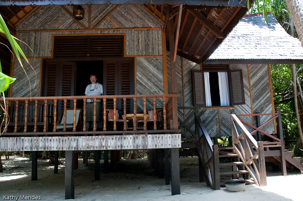 Randy on the verandah of our two-room chalet.