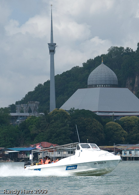One of the Lankayan speedboats with a mosque in the background.