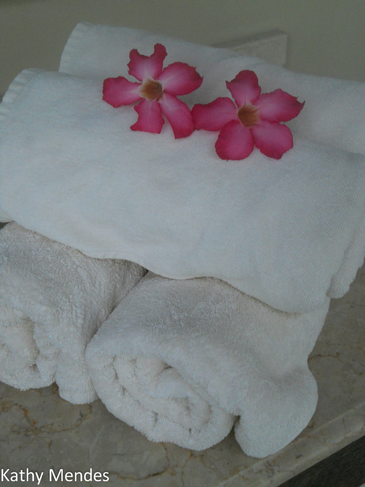 Fluffy White Towels and Fresh Flowers