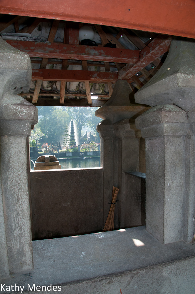 View of the Fountain through a Window