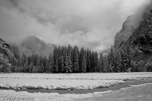 Snowy Yosemite Valley with Half Dome in the Clouds