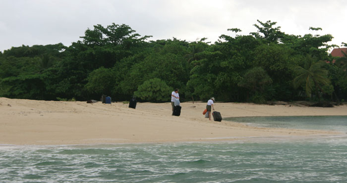 Dragging suitcases down the beach to the reception building on Selingaan Island. Photo courtesy India Marshall.