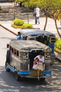 Mother and Child disembark from a Jeepney
