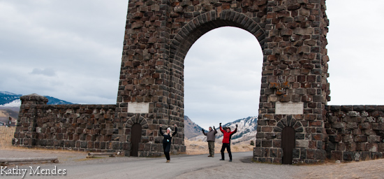 Celebrating our finally being there! At the historic North Gate to Yellowstone National Park