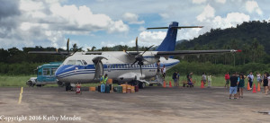 AirSwift unloading passengers and luggage at a tiny airstrip near El Nido.